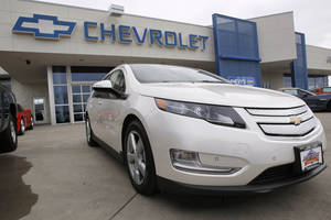 Photo -   FILE - This Feb. 19, 2012 file photo, shows a 2012 Chevrolet Volt at a Chevrolet dealership in the south Denver suburb of Englewood, Colo. Sales of the Volt set a monthly record of 2,800 in August, mostly because of steep discounts. (AP Photo/David Zalubowski, File)