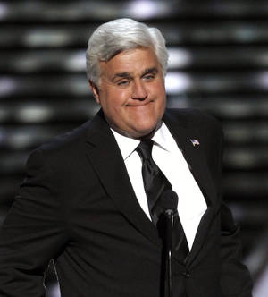 photo -   FILE - In this Wednesday, July 13, 2011 file photo, Jay Leno presents the Jimmy V Award for Perseverance at the ESPY Awards in Los Angeles. Published reports say The Tonight Show has laid off about two dozen workers and host Jay Leno has taken a large pay cut to save the jobs of other staffers, Saturday, Aug. 18, 2012. (AP Photo/Matt Sayles, File)