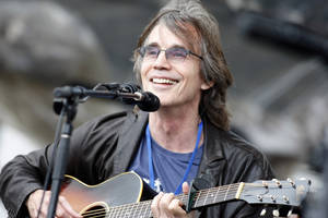 Photo - FILE - This July 29, 2012 file photo shows Jackson Browne performing at the Newport Folk Festival in Newport, R.I. Browne will perform at the Rock and Roll Hall of Fame induction ceremony on April 18 in Los Angeles. (AP Photo/Joe Giblin, file)