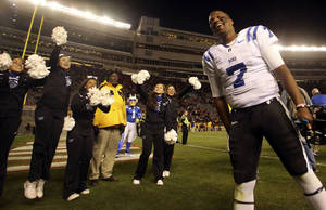 Photo - Duke quarterback Anthony Boone (7) celebrates in Lane Stadium after winning 13-10 over Virginia Tech in Blacksburg, Va., Saturday, Oct. 26, 2013. (AP Photo/The Roanoke Times, Matt Gentry)