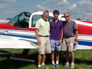 Photo - This photo Aug. 1, 2013 photo, courtesy of Sen. James Inhofe, R-Okla., shows from left, Inhofe's son Perry Inhofe, Inhofe's grandson Cole Inhofe and Sen. Inhofe in Oshkosh, Wis. Dr. Perry Inhofe, who was killed in a weekend plane crash in northeast Oklahoma. (AP Photo/Courtesy of Sen. James Inhofe, Ryan Jackson)