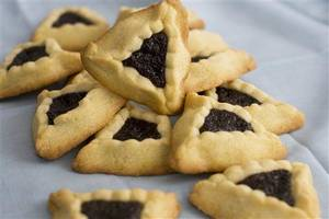 Photo - This image taken on Jan. 30, 2012 in Concord, N.H. shows triangular-shaped orange-poppy seed hamantashen cookies, a favorite for the Jewish holiday Purim. (AP Photo/Matthew Mead)