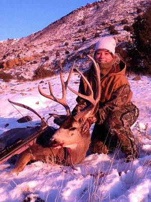 photo - Kelly Newman of Edmond took this mule deer with a crossbow on New Year's Day morning near the Black Mesa in the Panhandle. About 250 mule deer are harvested in Oklahoma each season. They are mostly found in the Panhandle counties of Cimarron, Texas and Beaver and northwestern counties of Harper, Ellis, Woods and Woodward. Bow season for deer in Oklahoma continues through Jan. 15. PHOTO PROVIDED