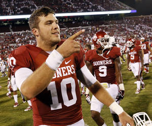 Photo - Oklahoma's Blake Bell (10) leaves the field at the end of the game after replacing Trevor Knight in the fourth quarter during a college football game between the University of Oklahoma Sooners (OU) and the West Virginia University Mountaineers at Gaylord Family-Oklahoma Memorial Stadium in Norman, Okla., on Saturday, Sept. 7, 2013. Photo by Steve Sisney, The Oklahoman