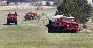 Photo - Brush pumpers arrive to battle a grass fire on farmland near East Camp Drive and Douglas Boulevard in Logan County, Monday May 05, 2014. Photo By Steve Gooch, The Oklahoman