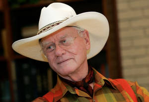 """Photo -   In this Thursday, Oct. 9, 2008 photo, actor Larry Hagman listens to a reporter's question while visiting the Southfork Ranch in Parker, Texas, made famous in the television show """"Dallas."""" Actor Larry Hagman, who for more than a decade played villainous patriarch JR Ewing in the TV soap Dallas, has died at the age of 81, his family said Saturday Nov. 24, 2012(AP Photo/Tony Gutierrez)"""