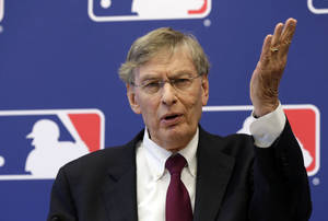 Photo - FILE - In this May 16, 2013 file photo, Baseball commissioner Bud Selig answers a question during a news conference at Major League Baseball headquarters, in New York. Selig says the sport's new replay system is working well despite a few problems during its first two weeks. (AP Photo/Richard Drew, File)