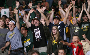 photo -   Baylor students and fans watch the broadcast on large video monitors in Waco, Texas, as Baylor takes on Notre Dame in the NCAA women's college basketball tournament Final Four championship game in Denver, Tuesday, April 3, 2012. Hundreds of fans gathered inside the Ferrell Center to watch the game. (AP Photo/Waco Tribune-Herald, Duane A. Laverty)