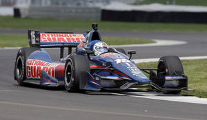 Photo - Graham  Rahal takes a turn during testing for the inaugural Grand Prix of Indianapolis auto race on the new road course at Indianapolis Motor Speedway in Indianapolis, Wednesday, April 30, 2014. (AP Photo/Michael Conroy)