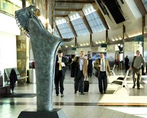 "Photo - Two bronze sculptures by Chiricahua Apache artist Allan Houser have been installed at Will Rogers World Airport in Oklahoma City. Standing eight feet tall and weighing nearly 1,000 pounds, the statue ""Prayer,"" right, is in the central concourse near the Coffee Bean & Tea Leaf. ""The Future"" statue is a bit smaller and is on the lower level by Baggage Claim 4.  Photo by Jim Beckel, The Oklahoman"