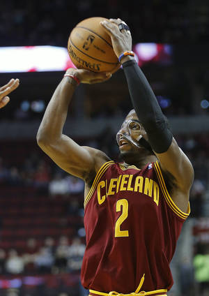 Photo - Cleveland Cavaliers guard Kyrie Irving shoots an outside shot during the first quarter of an NBA basketball game against the Portland Trail Blazers in Portland, Ore., Wednesday, Jan. 16, 2013.(AP Photo/Don Ryan)