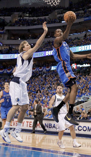 Photo - Thunder forward Kevin Durant, right, shoots as the Mavericks' Dirk Nowitzki defends during Game 1 of the Western Conference Finals on Tuesday in Dallas. The game did not end in time for this edition. For complete coverage, go to NewsOK.com. PHOTO BY BRYAN TERRY, THE OKLAHOMAN