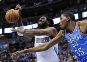 Photo - Oklahoma City Thunder forward Kevin Durant (35) knocks the ball from the hands of Denver Nuggets center Nene (31) from Brazil during the second half in game 4 of a first-round NBA basketball playoff series Monday, April 25, 2011, in Denver. (AP Photo/Jack Dempsey)