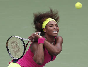 Photo -   Serena Williams returns a shot to Czech Republic's Andrea Hlavackova in the fourth round of play at the 2012 US Open tennis tournament, Monday, Sept. 3, 2012, in New York. (AP Photo/Julio Cortez)