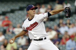 Photo - Cleveland Indians starting pitcher Ubaldo Jimenez delivers in the first inning of a baseball game against the Kansas City Royals, Monday, Sept. 9, 2013, in Cleveland. (AP Photo/Tony Dejak)