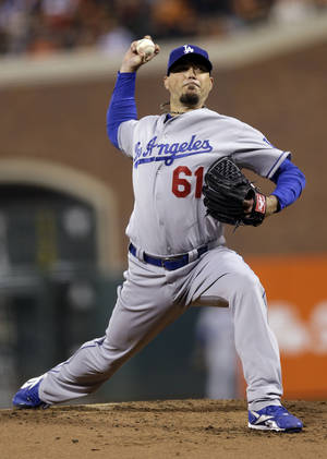 Photo -   Los Angeles Dodgers starting pitcher Josh Beckett throws to the San Francisco Giants during the first inning of a baseball game Friday, Sept. 7, 2012, in San Francisco. (AP Photo/Marcio Jose Sanchez)