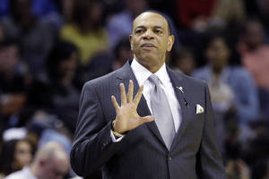 Photo - Memphis Grizzlies head coach Lionel Hollins signals during the first half of an NBA basketball game against the Los Angeles Lakers in Memphis, Tenn., Wednesday, Jan. 23, 2013. The Grizzlies won 106-93. (AP Photo/Daniel Johnston)