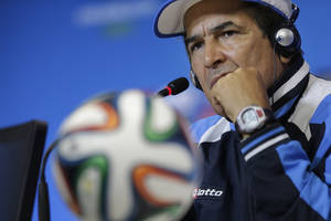 Photo - Costa Rica's coach Jorge Luis Pinto listens to questions during a press conference in Salvador, Brazil on Friday, July 4, 2014. Costa Rica play their quarterfinal match of the 2014 World Cup soccer tournament against Netherlands on July 5 in Salvador.(AP Photo/Wong Maye-E)