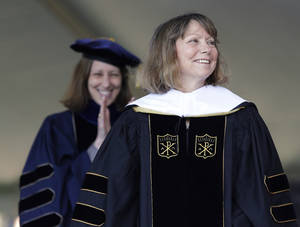 Photo - Jill Abramson, former executive editor of The New York Times, receives an honorary Doctor of Humane Letters degree during the commencement ceremony Monday, May 19, 2014 at Wake Forest University in Winston-Salem, N.C. It was Abramson's first public appearance since her dismissal from The New York Times. (AP Photo/Nell Redmond)