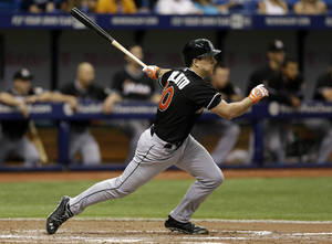 Photo - Miami Marlins' Jacob Realmuto follows through on a sixth inning RBI single off Tampa Bay Rays relief pitcher Jake McGee during an interleague baseball game Thursday, June 5, 2014, in St. Petersburg, Fla. Marlins' Garrett Jones scored on the hit. (AP Photo/Chris O'Meara)