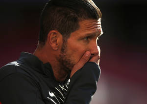 Photo - Atletico's coach Diego Simeone gestures, during a training session ahead of Saturday's Champions League final soccer match between Real Madrid and Atletico Madrid, in Luz stadium in Lisbon, Portugal, Friday, May 23, 2014. (AP Photo/Daniel Ochoa de Olza)
