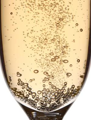 Photo - To toast properly, use a tall, slim flute, so you can watch the bubbles rise. Thinkstock photo