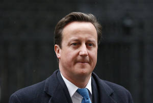 photo -   FILE - In this Wednesday, April 25, 2012 file photo Britain's Prime Minister David Cameron walks from number 10 Downing Street to attend Prime Minister's Questions at the Houses of Parliament in London. David Cameron says he discussed News Corp.'s bid to take full control of a British broadcaster with James Murdoch, but denies promising to support the deal in return for favorable coverage from the media giant's newspapers. Cameron told BBC television Sunday April 29, 2012 that he had chatted about the takeover bid with James Murdoch at a Christmas party, but insisted he had not brokered any tit-for-tat deal with him or his media mogul father Rupert Murdoch. (AP Photo/Matt Dunham, File)