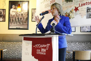 Photo - Oklahoma Gov. Mary Fallin announces her reelection campaign at the Old School Bagel Cafe in Tulsa, Okla. on Thursday, Oct. 17, 2013, as she formally launched her bid for a second term in office (AP Photo/Tulsa World, Matt Barnard)