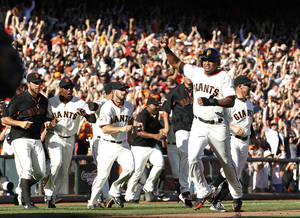 Photo - San Francisco Giants second baseman Tony Abreu gestures as he scores the winning run on a single by Hunter Pence against the San Diego Padres during the ninth inning of a baseball game in San Francisco, Sunday, Sept. 29, 2013. The Giants won 7-6. (AP Photo/Tony Avelar)