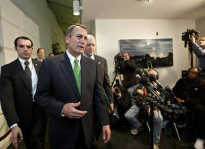 "photo - Speaker of the House John Boehner, R-Ohio, walks with House Ways and Means Committee Chairman Dave Camp, R-Mich., following a closed-door GOP meeting as the ""fiscal cliff"" bill passed by the Senate Monday night waits for a vote in the Republican-controlled House, at the Capitol in Washington, Tuesday Jan. 1, 2013.  (AP Photo/J. Scott Applewhite)"