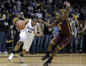photo - Colorado's Brittany Wilson,left,  dribbles past Arizona State's  Micaela Pickens during an  NCAA college basketball game  Friday, Jan. 18,  in Boulder, Colo. (AP Photo/The Daily Camera, Jeremy Papasso)