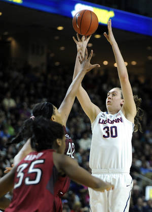 Photo - Connecticut's Breanna Stewart (30) shoots over Temple's Taylor Robinson (42) during the second half of Connecticut's 80-36 victory in an NCAA college basketball game in Bridgeport, Conn., Saturday, Jan. 11, 2014. (AP Photo/Fred Beckham)