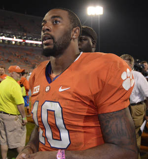 Photo - Clemson quarterback Tajh Boyd (10) walks of the field after the second half of an NCAA college football game against Florida State, Sunday, Oct. 20, 2013, in Clemson, S.C. Florida State won 51-14. (AP Photo/Richard Shiro)