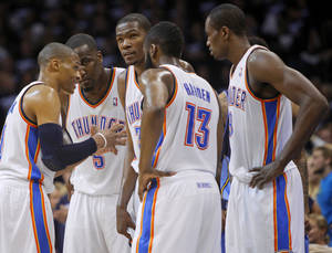 Photo - From left, Oklahoma City's Russell Westbrook (0), Kendrick Perkins (5), Kevin Durant (35), James Harden (13), and Serge Ibaka (9) gather during the NBA basketball game between the Denver Nuggets and the Oklahoma City Thunder in the first round of the NBA playoffs at the Oklahoma City Arena, Wednesday, April 27, 2011. Photo by Bryan Terry, The Oklahoman ORG XMIT: KOD
