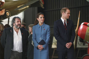 Photo - Britain's Prince William, right, and his Kate, the Duchess of Cambridge, are guided on a tour of the Omaka Aviation Heritage Centre by film director Peter Jackson, in Blenheim, New Zealand, Thursday, April 10, 2014. (AP Photo/Tim Cuff, Pool)