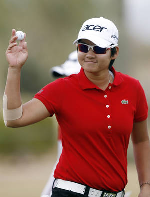 Photo - In this March 17, 2012 file photo, Yani Tseng, of Taiwan, waves to the crowd after making par on the ninth hole during the third round of the Founder's Cup golf tournament in Phoenix. (AP Photo/Paul Connors, File)
