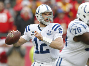 Photo - Indianapolis Colts quarterback Andrew Luck (12) looks for a receiver during the first half of an NFL football game against the Kansas City Chiefs in Kansas City, Mo., Sunday, Dec. 22, 2013. (AP Photo/Ed Zurga)