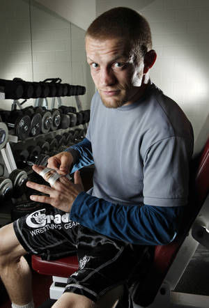 Photo - Former University of Oklahoma (OU) wrestler Sam Hazewinkel works out in preparation for the U.S. Olympic trials on Tuesday, April 17, 2012, in Norman, Okla.  Photo by Steve Sisney, The Oklahoman ORG XMIT: SSOK101