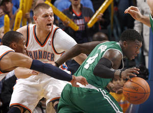 photo - Oklahoma City&#039;s Russell Westbrook and Cole Aldrich pressure Nate Robinson during the NBA game between the Oklahoma City Thunder and the Boston Celtics, Sunday, Nov. 7, 2010, at the Oklahoma City Arena. Photo by Sarah Phipps, The Oklahoman 
