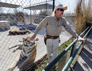photo - Joe Schreibvogel talks Thursday about a lawsuit at GW Exotic Animal Park in Wynnewood.  Photo by Steve Sisney, The Oklahoman