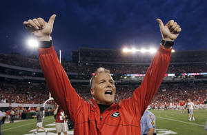 photo -   Georgia coach Mark Richt gestures after Georgia defeated Tennessee 51-44 in an NCAA college football game Saturday, Sept. 29, 2012 in Athens, Ga. (AP Photo/John Bazemore)