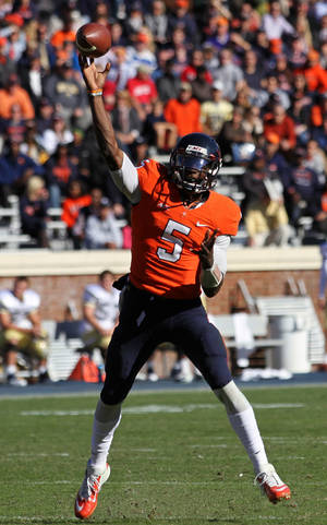 Photo - Virginia quarterback David Watford (5) throws a pass down field against Georgia Tech in the second half  of an NCAA college football game Saturday, Oct. 26, 2013, at Scott Stadium in Charlottesville, Va. (AP Photo/The Daily Progress, Ryan M. Kelly)