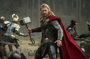 "Photo - This publicity photo released by Walt Disney Studios and Marvel shows Chris Hemsworth in a scene from ""Thor: The Dark World."" The movie releases in the US on Friday, Nov. 8. 2013. (AP Photo/Walt Disney Studios/Marvel, Jay Maidment)"