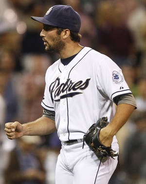 photo -   San Diego Padres closer Huston Street pumps his fist after getting the final out of the Padres 2-1 victory over the Los Angeles Dodgers during a baseball game Tuesday, Sept. 25, 2012 in San Diego. Street got Matt Kemp to fly out with the tying run on third base. (AP Photo/Lenny Ignelzi)