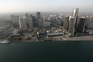 """Photo - FILE - In this Nov. 2, 2005 file photo, the Detroit skyline is shown along the Detroit River. Detroit has reached a tentative deal with unions that represent thousands of employees in the bankrupt city. Mediators announced Monday, April 28, 2014 that the city and the Coalition of Detroit Unions have agreed in principle on the """"major aspects"""" of a five-year collective bargaining agreement.(AP Photo/Paul Sancya, File)"""