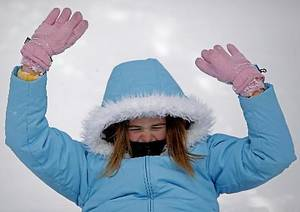Photo - Kaylin Varney, 11, slides down a hill after a snowstorm Tuesday in Oklahoma City. Photo by Bryan Terry, The Oklahoman
