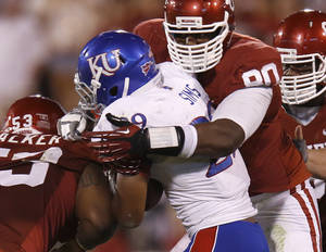 photo - OU's David King (90) brings down KU's James Sims (29) during the college football game between the University of Oklahoma Sooners (OU) and the Kansas Jayhawks (KU) at Gaylord Family-Oklahoma Memorial Stadium in Norman, Okla., Saturday, Oct. 20, 2012. Photo by Bryan Terry, The Oklahoman