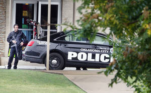 Photo - Oklahoma City Police take position during a standoff with a suspect near SW 39th and Pennsylvania. The suspect shot himself before he could be taken into custody, police said. <strong>Steve Gooch - The Oklahoman</strong>