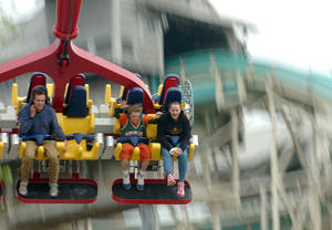 Photo - FILE - In this Thursday, May 4, 2006, file photo, people ride the Skyhawk, at Cedar Point amusement park, in Sandusky, Ohio. Park officials closed Cedar Point on Saturday, June 7, 2014, after a water main break in the city of Sandusky disrupted its primary water supply. (AP Photo/Sandusky Register, Jason Werling, File)