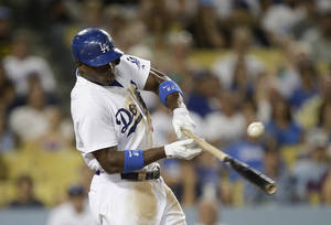 Photo - Los Angeles Dodgers' Yasiel Puig hits a RBI single during the second inning of a baseball game against the San Diego Padres on Friday, Aug. 30, 2013, in Los Angeles. (AP Photo/Jae C. Hong)
